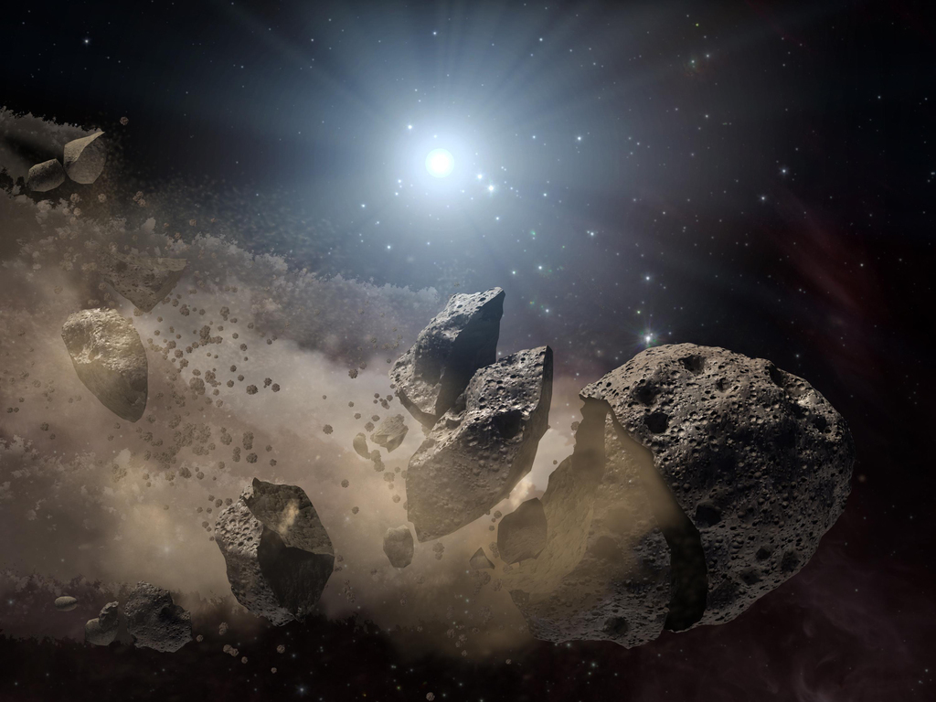Artist impression van een uiteenspattende asteroïde. – © NASA