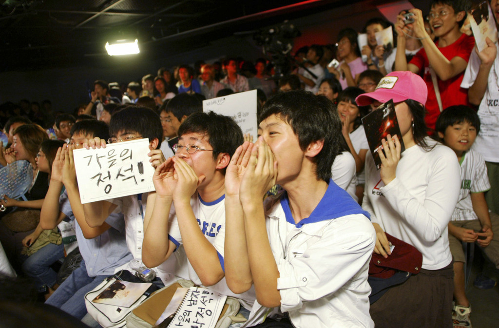 Fans moedigen hun favoriete gamers aan. – © Chung Sung-Jun / Getty Images