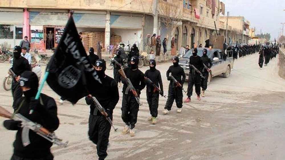 Strijders van IS in Raqqa, de hoofdstad van het 'kalifaat', in 2014. – © HH