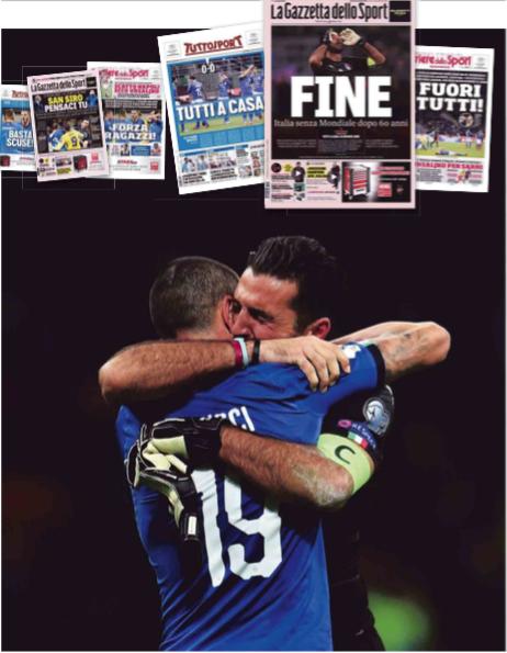 Gianluigi Buffon en Leonardo Bonucci omhelzen elkaar na de fatale play-off tegen Zweden in het San Siro-stadion in Milaan. – © Claudio Villa / Getty