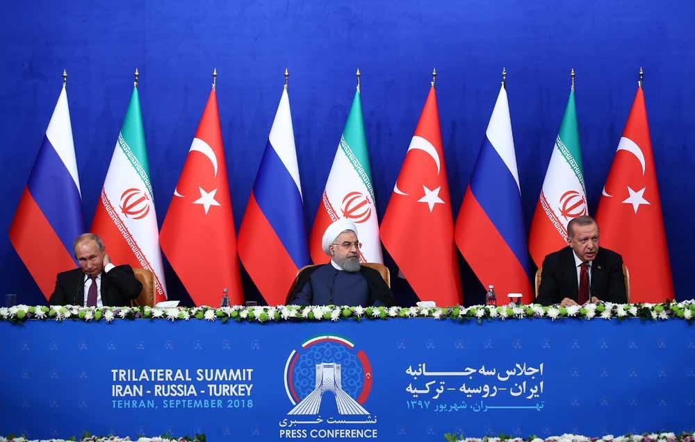 De presidenten Erdogan, Rouhani en Poetin houden een persconferentie na de drielandentop tussen Turkije, Iran en Rusland in Teheran, 7 september 2018. © Getty Images