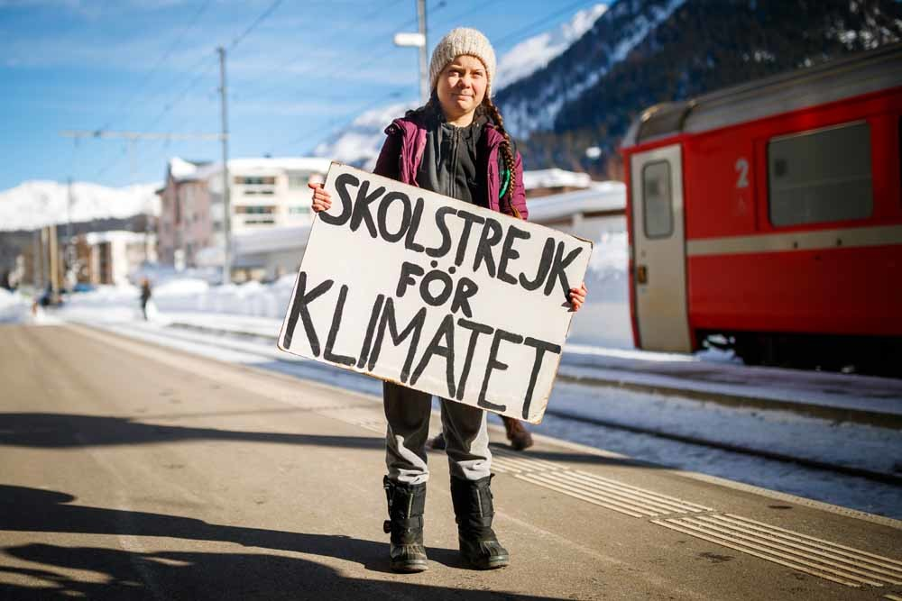 Greta Thunberg (16) arriveert in Davos voor de jaarlijkse meeting van het World Economic Forum, 23 januari 2019. – © Valentin Flauraud/Keystone via AP