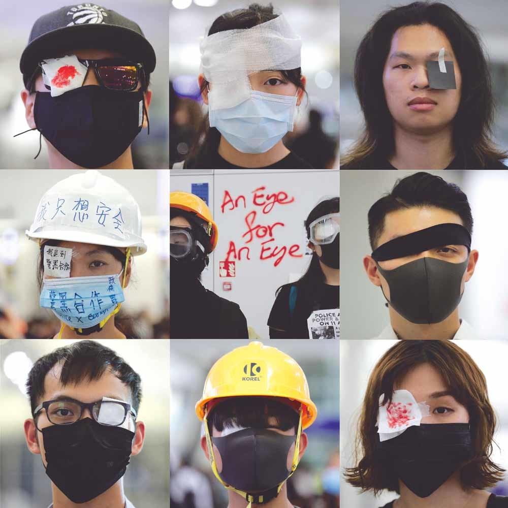 Demonstranten in Hongkong dragen ooglapjes uit solidariteit met een mededemonstrant die zijn oog is verloren door een rubberkogel.  © Kin Cheung / AP Photo