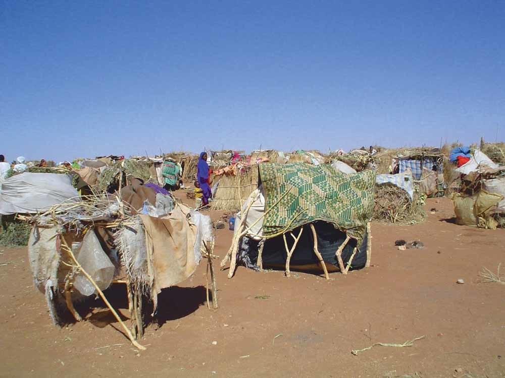 Vluchtelingenkamp in Zuid-Darfur. Volgens Elbasri trad de VN niet op tegen het systematische geweld van Soedanese regeringstroepen. – © USAID